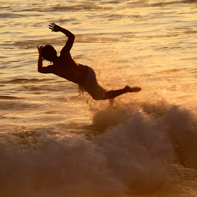 surfer by Cristobal Garciaferro Rubio - People Portraits of Men ( water, shore, pwcsilhouettemotion, surfer, waves, sunset, sea )