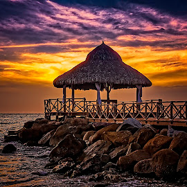 Night Cap - On the Rocks by Scott Hryciuk - Buildings & Architecture Other Exteriors ( clouds, water, sand, mexico, sunset, palapa, ocean, beach, rocks )