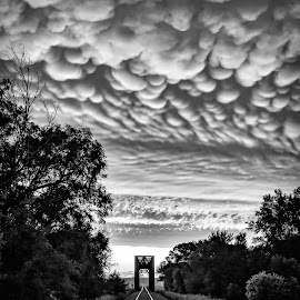 Into the Sunset by Rachaelle Larsen - Landscapes Cloud Formations ( mammatus clouds, train tracks, train bridge, mammatus )
