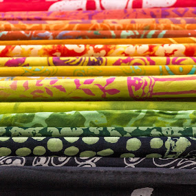 Colorful fabric on the market. by Roger Hamblok - Artistic Objects Other Objects ( circle, yellow, drawing, circles, bandana, cloth, scheme, layout, pile, marking, fabric, black, orange, sketch, trace, green, white, canvas, accumulation, curtain, red, rag, pattern, blue, fuchsia, lines, stack, design,  )