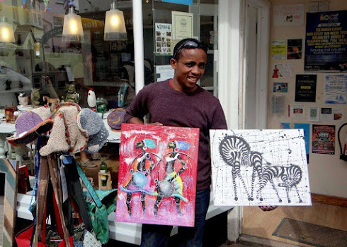 Tanzanian Artist outside our shop