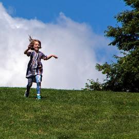 by Judy Florio - Babies & Children Children Candids ( playing, child, field, clouds, joyful, hill, free, girl, sky, tree, grass, running )