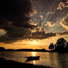 by Joseph Balson - Landscapes Waterscapes ( god rays, nature, sky and clouds, backlight, sunset - sunrise, style, water, lake, boat, landscape, transportation,  )