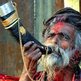 Blowing the horn.... by Gautam Tarafder - People Portraits of Men