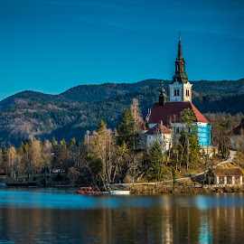 by Mario Horvat - Buildings & Architecture Places of Worship ( winter, church, sunset, outdoor, bled, lake )