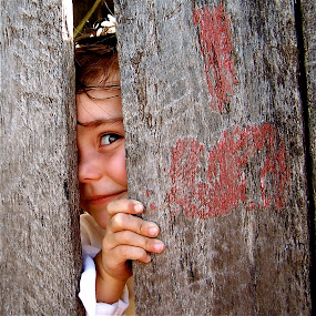 by Lori Lei Herr - Babies & Children Children Candids ( expression, wood, peeking, children, child, farm, red, girl, peek-a-boo, color, fall, peek, toddler, crate, surprise )