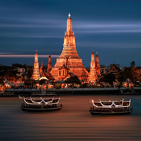 Wat Arun by Bendik Møller - Buildings & Architecture Places of Worship ( illuminated, water, nightshot, boats, architecture, travel, boat, nightscape, bangkok, temple, religion, sky, night photography, color, outdoors, outdoor, night, built, nautical, travel photography, travel locations, river )