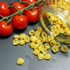by Dipali S - Food & Drink Ingredients ( raw, shell, italian, uncooked, cuisine, diet, yellow, dried, pile, cooking, ingredient, top, portion, shells, dry, texture, white, pasta, nutrition, food, background, serving, healthy, macaroni, view, small )