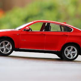 Toy BMW X6 by Ashish Daga - Artistic Objects Toys ( blurred, macro, red, toy, zoom, x6, bmw, blur )