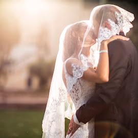 Kiss 4860 by Keith Darmanin - Wedding Bride & Groom ( kiss, wedding photography, kitz klikz, malta, wedding day, wedding, veil, wedding photographer, keith darmanin, sun, kitzklikz, photography )