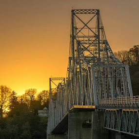 by Bob White - Buildings & Architecture Bridges & Suspended Structures ( water, picoftheday, iowa, skyline, sky, onlyiowa, vintage, mississippi river, sunset, iron bridge, golden, river,  )