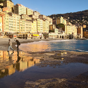 camogli glimpse by Donatella Tandelli - Travel Locations Landmarks ( italian landscape, reflection, walking, yellow, beach, coast, village, liguria, buildings, couple, rocks, italy, water, romantic, sea, tourism, genoa, seascape, sunlight, relaxing, winter, bay, blue, camogli, sunset, wave, puddle, historical, golden, foam )