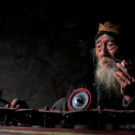 old gamelan players by Tiz Brotosudarmo - People Musicians & Entertainers