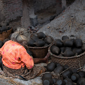 Pottery Maker by Garrett Dyer - People Street & Candids ( clay, woman, pottery, pots, nepal )