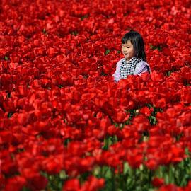 Little tulip girl by Bencik Juraj - Babies & Children Children Candids ( child, child portrait, flower )