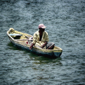 Fisherman by Jeff Dalton - People Portraits of Men ( picture, water, nature, pictures, fishing, fisherman, boat, people, photography, man )