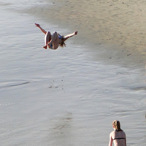 by Liz Rosas - News & Events World Events ( back flip, beach aerial flip, gymnastics, gymnast )