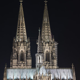 Cologne Cathedral at night by Johannes Oehl - Buildings & Architecture Places of Worship ( tourist attraction, impressed, skyline, old, gothic, arch, cloudless, lancet window, north rhine-westphalia, tranquil scene, stone, bell tower, medieval architecture, architecture, historic, religion, ancient, midnight, color image, general view, pointed arch, germany, lancet arch, 16th century, european culture, majestic, architecture-photography, one object, hipped roof, unesco, metal roof, soaring, huge, magnificent, european, window, outdoors, roman catholic church, nordrhein-westfalen, cathedral, tranquility, symmetry, catholic church, outside, culture, statuesque, cross, brilliance, colossal, cologne, famous, trachyte, europe, christianity, deep focus, complexity, beauty, creative image, crucifix, perfection, exterior view, tranquillity, ogive, nighttime, tradition, long exposure, external view, cologne cathedral, tall, gigantic, 13th century, building, peaceful, middle ages, night scene, beautiful, 19th century, high cathedral of saint peter, 14th century, scenic, church window, 15th century, history, continuity, catholicism, tower, peace, towering, night, flood light, dark age, medieval, unesco world heritage )