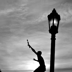 Mallory Square Street Performer by Lizz Condon - City,  Street & Park  Street Scenes ( mallory square, sunset, performer, juggle, key west )