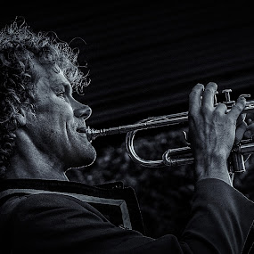 Make a Beautiful Sound by Garry Dosa - Black & White Portraits & People ( music, concert, person, monochrome, b&w, black & white, male, trumpet, instrument, toned selenium, stage, bokeh, holiday, band, hands, canada day, outdoors, action, performing, musician, hair,  )