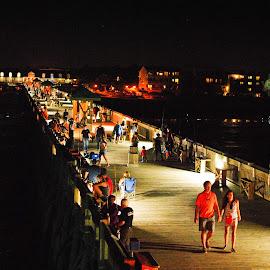 Pier at Night by Prentiss Findlay - City,  Street & Park  Night ( holding hands on pier at night, ocean pier, pier, beach pier, pier at night )