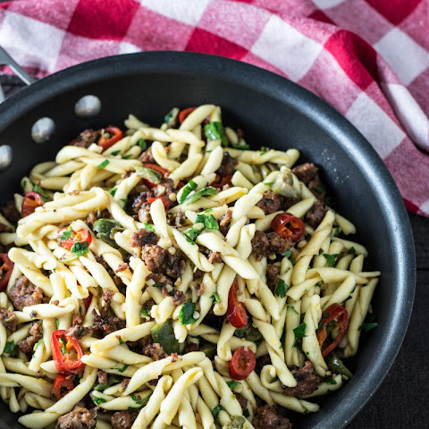 Strozzapreti with Lamb Sausage, Chilies & Olives