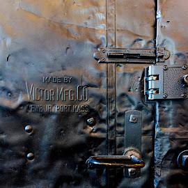 Victor Mfg. Co. by David Stone - Buildings & Architecture Other Interior ( hardware, metal, lock, reflections, door, black, door handle )