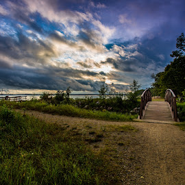 Bridge Over Bemidji Water by Dayton Bintz - Landscapes Cloud Formations ( water, clouds, trees, lake, bridge )