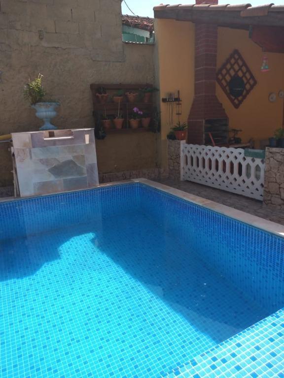 Casa térrea com piscina e edícula SÓ PERMUTA - Oceanópolis - Mongaguá/SP