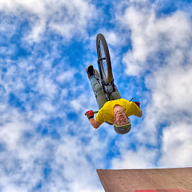 Salto by Marco Bertamé - Sports & Fitness Other Sports ( clouds, wheel, speed, white, yellow, stunt, upside down, bicycle, ramp, jump, flying, sky, blue, salto, cloudy, high, ait )