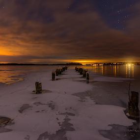 W a l k i n g - O n - T h i n - I c e by Manu Heiskanen - Uncategorized All Uncategorized ( clouds, sweden, reflection, old, eskilstuna, star, solitude, frozen, paulinawolekpardon, winter, sky, pole, stars, ice, snow, bridge, lonely,  )