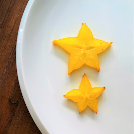 Two yellow stars of carambola by Svetlana Saenkova - Food & Drink Fruits & Vegetables ( carambola, 2, star, yellow, yellow fruit, two )
