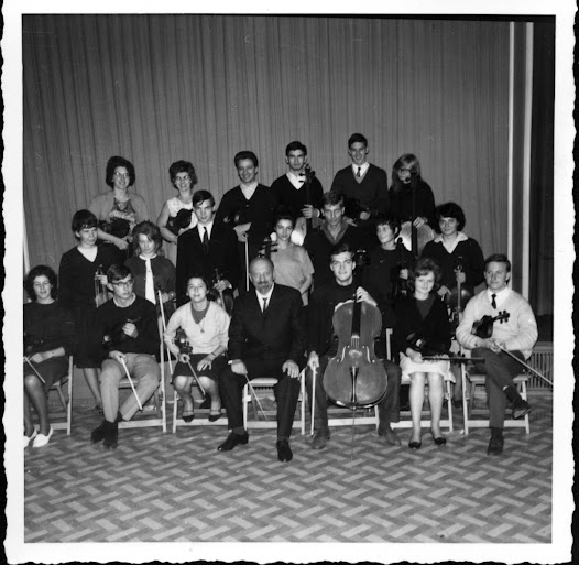 Matz sits with a group of young musicians with whom he worked at the Bayreuth festival.