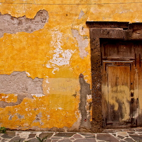 Yellow wall and brown door, San Miguel de Allende, Mexico by Stephanie Walsh - Buildings & Architecture Other Exteriors ( yellow wall, crumbling wall, san miguel de allende, mexico, street, rusty door, brown door, old building,  )