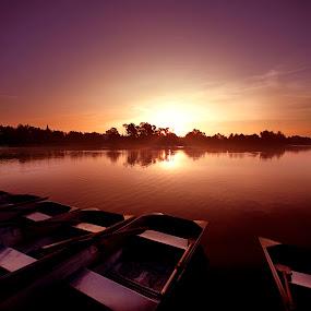 sunrise at lagoon by Cristobal Garciaferro Rubio - Landscapes Sunsets & Sunrises ( water, reflection, lagoon, rise, boats, lake, sunrise, boat, sun )
