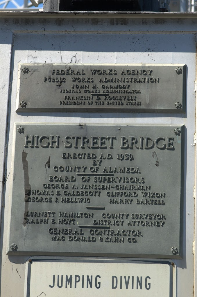 High Street BridgeErected A.D. 1939byCounty of Alameda---Board of SupervisorsGeorge A. Janssen - ChairmanThomas E. Caldecott   Clifford WixonGeorge P. Hellwig   Harry Bartell---Burnett Hamilton  ...