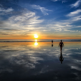 Walking on water by Justin Mckinney - Landscapes Waterscapes ( reflection water cable beach sunset walking people clouds cloud cloudscape sun ocean sea dusk relax west western australia landscape image )