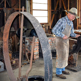 Elderly man still working at his trade. by Priscilla Renda McDaniel - People Portraits of Men ( blacksmith, gives a talk, elderly man, trade, cute, working )