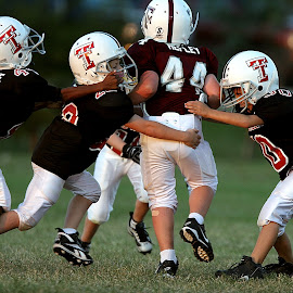 Bringing down the big boy by Keith Johnston - Sports & Fitness American and Canadian football ( field, football, opponents, opposition, action, game, runner, tackle, team, youth, competition )