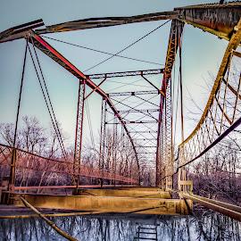 Oklahoma deckless bridge.  by Paul Haines - Buildings & Architecture Bridges & Suspended Structures