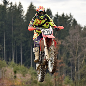 Sporty Forthy by Marco Bertamé - Sports & Fitness Motorsports ( flying, red, motocross, speed, 40, air, number, high, yellow, race, noise, jump )