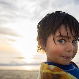 Boyhood by Giovanni Paredes - Babies & Children Child Portraits ( clouds, sand, playful, clouds and sea, ocean, beach, coast, portrait, eyes, child, nature, autumn, color, sunset, boy )