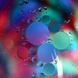 Floating by Janet Herman - Abstract Macro ( abstract, oil drops, oil and water, macro, colors, reflections )