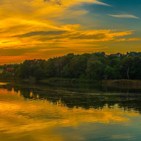 Across the lake by Opreanu Roberto Sorin - Landscapes Sunsets & Sunrises ( water, sky, refelction, park, sunset, cloudy, forest, lake, light, sun,  )