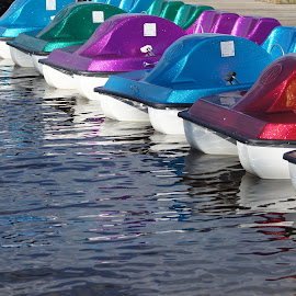 colorful paddlers by Amber O'Hara - Artistic Objects Still Life ( paddle baots, reflection, reds, lake, blues,  )