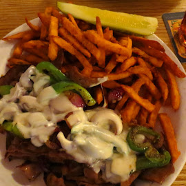 Philly Cheesesteak by Rita Goebert - Food & Drink Plated Food ( gallup, new mexico; philly cheesesteak; sweet potato fries; atmosphere; historic memorabilia )