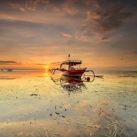 Sunrise  by Bobo Tandiono - Transportation Boats ( boat.seaweed. clouds. waterscape )