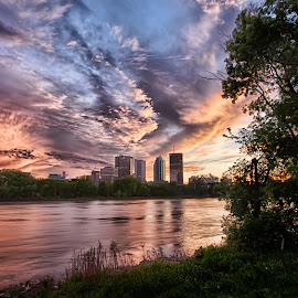 Winnipeg Sunset by Jim Harvey - City,  Street & Park  Skylines ( clouds, red river, sunset, winnipeg, manitoba )