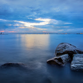 Rocks on Blue Beach by Calvin Chan - Landscapes Beaches ( clouds, dawn, blue, sea, ships, beach, hour, sunrise, landscape, rocks )