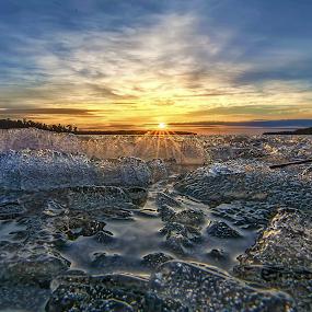 I c e - B i t t e. by Manu Heiskanen - Uncategorized All Uncategorized ( water, winter, sunset, ice, bubbles, spring, sun, paulinawolekpardon )